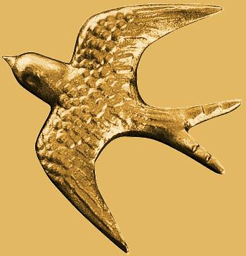 Kuvassa oleva koriste haudalle pronssipääskynen on väritykseltään pronssinen, sekä se on kolmiulotteinen.