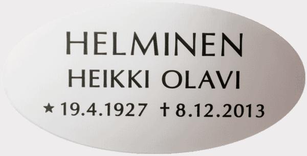 Kuvassa on Ovaali teräslaatta (muistolaatta). Kuvan muistolaatta on valkea ja soikea. Teksti on laitettu mustalla.
