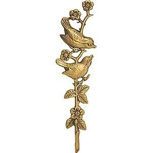 5) Pronssikoriste linnut oksalla koriste